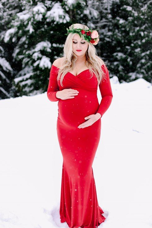 red dress maternity shoot in the snow winter photography floral .