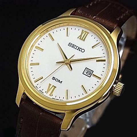 BRIGHT: SEIKO/Quartz Lady's watch gold case brown Leather strap .