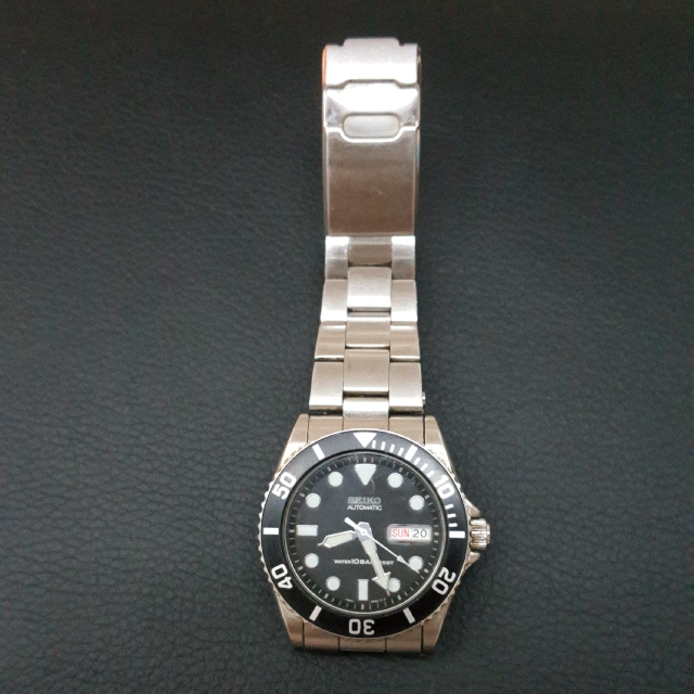 Seiko SKX031 Classic Watches, Men's Fashion, Watches on Carouse